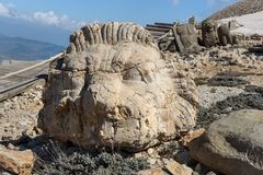 Lion statue at West Terrace on top of Nemrut Mountain.Turkey. Lion statue at West Terrace on top of Nemrut Mountain. Stone heads at the top of 2150 meters high royalty free stock images
