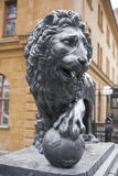 Lion statue, which rests on a globe with a royal crown. Royalty Free Stock Photography