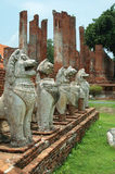 Lion Statues, Antiquities. The thai art lions guard around a very old Buddhist church or pagoda in ancient capital city Ayuthaya ,Thailand royalty free stock photo