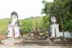 Lion statues at the couple. Walked up the stairs to the temple on the mountain royalty free stock photo