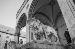 Lion statues in front of the Feldherrnhalle in black and white. Two Lion statues in front of the Feldherrnhalle in black and white stock photos