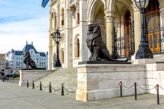 Lion statues at Hungarian parliament entrance in Budapest royalty free stock images