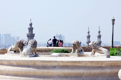 Egypt. Lion statues with islamic architecture from salahaldin citadel in cairo in egypt and visitors watching royalty free stock image