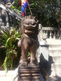 Lion statues in Khmer Style. Lion statues were carved from stone.The decor is often seen as a monument of Khmer stock images