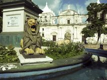 Lion statues Parque Central with Cathedral Leon in background Ni. Caragua Central America with tomb of Maximo Jerez Royalty Free Stock Images