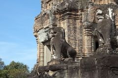 Lion statues protecting the ruins of 10th Century East Mebon temple. Scene around the Angkor Archaeological Park. The site contains the remains of the different Stock Photos
