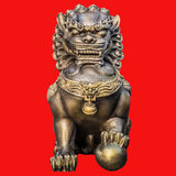 Lion statues. On red background. Image include clipping path stock photo