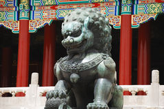 Lion stature near temple Stock Photos