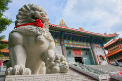 Lion stepping world as stone statue perspective Royalty Free Stock Photo