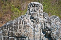 Lion stone sculpture. Large lion stone sculpture, taken on sunny afternoon Stock Photography