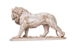Stone lion statuettes, left view. Lion stone statuettes isolated on white background Royalty Free Stock Images