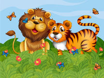 A lion, tiger and butterflies in the garden Stock Images