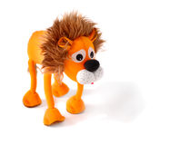 Lion-Toy. Ruffled sad lion isolated over white background Stock Photo