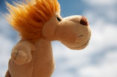 Lion toy. Soft toy - a lion toy with sky and clouds as background Stock Photos