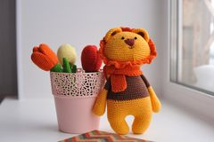 Amigurumi toy. Lion with tulips. Lion toy knitted in the technique of knitting amigurumi Stock Photography