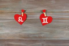 Lion and twins. signs of the zodiac and heart. wooden backgroun. D. card. Love. unusual handwork royalty free stock photography