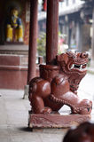 A lion under the column of a Chinese Temple Royalty Free Stock Photography