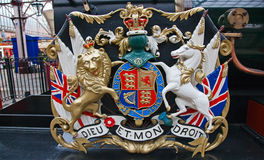 Lion and unicorn. On English heraldic coat of arms on an ancient steam train in Windsor Royalty Free Stock Image