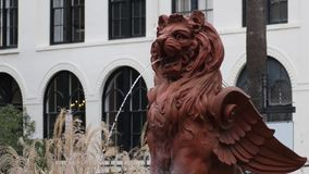 Lion water fountain sculpture in southern American city stock video footage