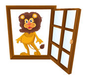 A lion in a window Royalty Free Stock Photography