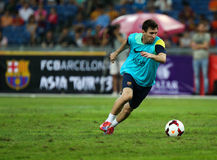 Lionel Andres Messi. KUALA LUMPUR - AUGUST 09: Barcelona Football Club striker Lionel Messi dribbles the ball during training session at the Bukit Jalil National Stock Photos
