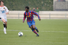 Lionel Enguene plays with F.C Barcelona youth team against Gimnastic de Tarragona at Ciutat Esportiva Joan Gamper Stock Images
