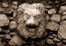 Lionface. Roman Lion sculpture in garden Stock Image