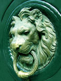 Lionhead knocker. Door royalty free stock image