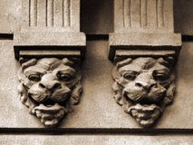 Lions. Lion heads on wall. House guards royalty free stock photography