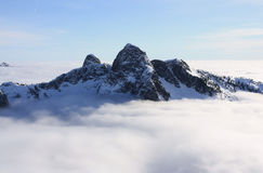 The Lions above the clouds in North Shore Mountains, BC, Canada. Royalty Free Stock Photography