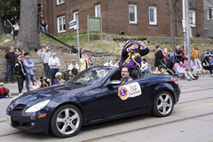 The Lions Club president greets viewers along Queen Street East Toronto in the Beaches Easter Parade 2017 Stock Photo