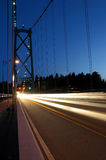 Lions Gate Bridge. The Lions Gate Bridge in Vancouver Canada at night with light streams from traffic Stock Images