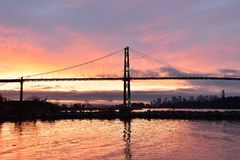 Lions Gate Bridge and Downtown Vancouver at sunrise Stock Photography