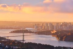 Lions Gate Bridge and Downtown Vancouver at sunrise Royalty Free Stock Photo