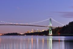 Lions Gate Bridge and Downtown Vancouver at sunset Royalty Free Stock Photography