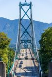 Lions Gate Bridge framed by trees on a clear day stock images