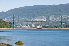 Lions Gate Bridge framing a ship on a clear summers day stock images