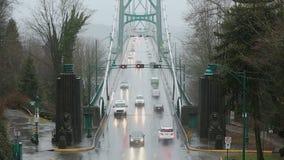 Lions Gate Bridge Rain, Commuter Traffic. Commuter traffic on the Lions Gate Bridge during a heavy rain storm. Vancouver, BC., Canada stock video footage