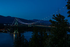 Lions Gate Bridge, Sunset and evening in Vancouver, Canada. Lions Gate Bridge, Sunset and evening of the beautiful town on Pacific Ocean in Vancouver Canada Royalty Free Stock Photography
