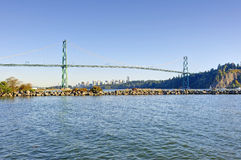 Lions gate bridge from West Vancouver, Canada - with Vancouver city center in the background and a jetty in the foreground Royalty Free Stock Image