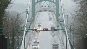 Lions Gate Bridge Wet Weather. Commuter traffic on the Lions Gate Bridge during a heavy rain storm. Vancouver, BC., Canada stock footage