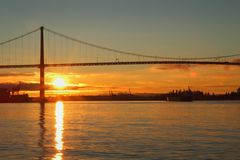 Lions Gate Sunrise Freighter, Vancouver Royalty Free Stock Photography