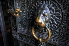 Lions head doorknob on an old church door Stock Image