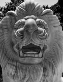 Lions Head Stone Calving Black White. Stone calving of lions head and face with its mane in black and white Royalty Free Stock Images