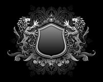 Lions holding shield insignia Stock Photos