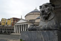 Lions Statue and Chiesa di San Francesco di Paola. Ons Statue foreground and Chiesa di San Francesco di Paola in the middle on the famous grand Piazza del stock photography