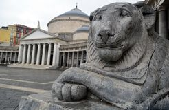 Lions Statue and Chiesa di San Francesco di Paola. Ons Statue foreground and Chiesa di San Francesco di Paola in the middle on the famous grand Piazza del royalty free stock images