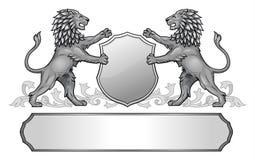 Lions tenant la crête de bouclier Photographie stock libre de droits
