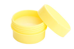Lip balm. In a yellow pot isolated on white background royalty free stock images