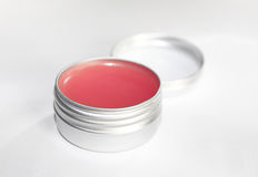 Lip balm. Pink lip balm in the container Royalty Free Stock Image